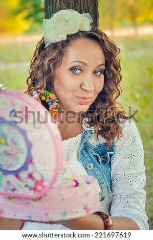 Pregnant woman in the park - stock photo