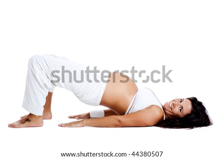 Pregnant woman making fitness exercises, isolated on white - stock photo