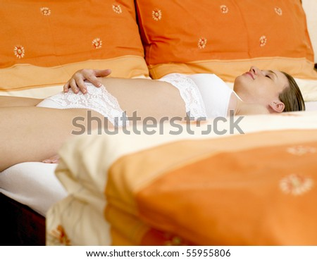 pregnant woman on bed