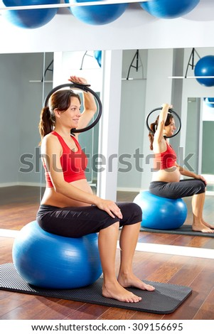 pregnant woman pilates exercise magic ring with fitball - stock photo
