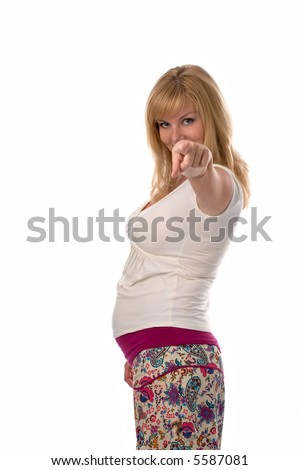 pregnant woman pointing forward with her finger, isolated on white - stock photo