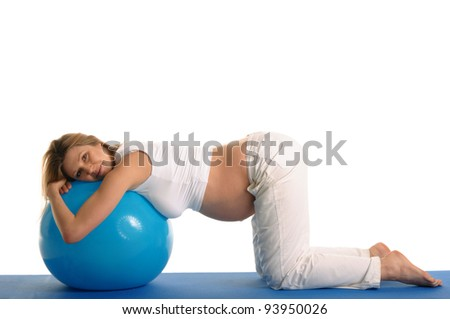 pregnant woman practicing yoga with blue ball isolated on white - stock photo
