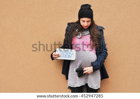 Pregnant woman. Pregnancy. A photo of a cute caucasian pregnant woman. - stock photo
