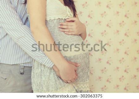 pregnant woman's belly, parents expect the child's birth - stock photo