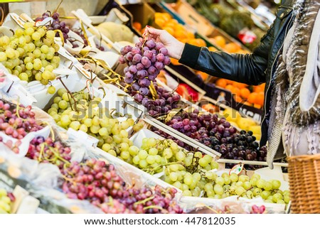 Pregnant woman shopping groceries on farmers market - stock photo