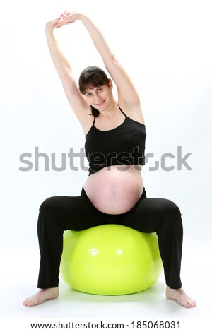 Pregnant woman sitting on a fitness ball