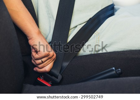 Pregnant woman wear safety belt in the car - stock photo