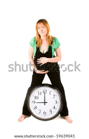 pregnant woman with a clock on white background - stock photo