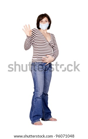 Pregnant woman with a medic mask. Isolated on white. - stock photo