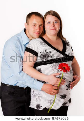 Pregnant woman with her husband - stock photo