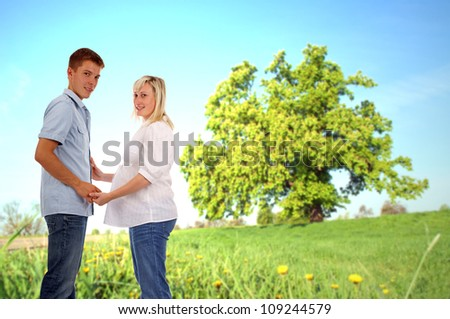 pregnant woman with her man in nature