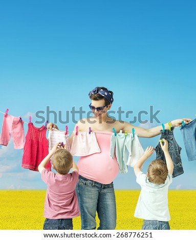 Pregnant woman with her sons - stock photo