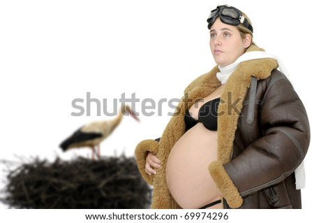 Pregnant woman with pilot jacket and goggles and a stork - stock photo