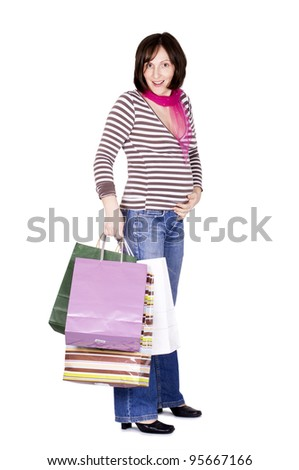 Pregnant woman with shopping bags. Isolated on white. - stock photo