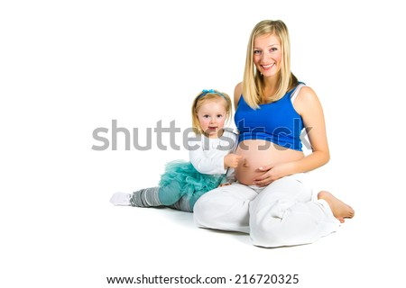 Pregnant woman with 2 zo daughter on white