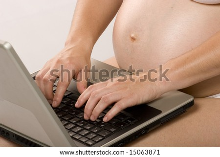 Pregnant woman working on a laptop