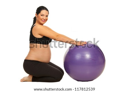 Pregnant woman workout with a pilates ball isolated on white background