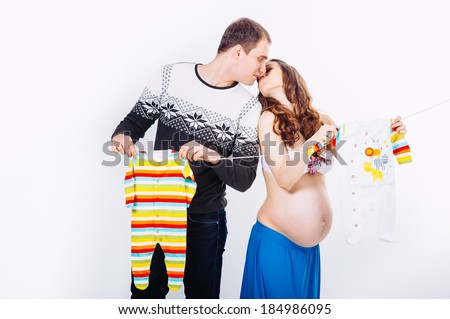 Pregnant young beautiful woman and man isolated on white background. happy pregnant couple isolated on white. Waiting for the baby / Young pregnant women with her husband - stock photo