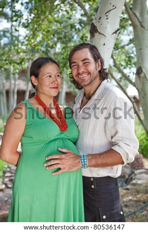 Pregnant young couple - stock photo