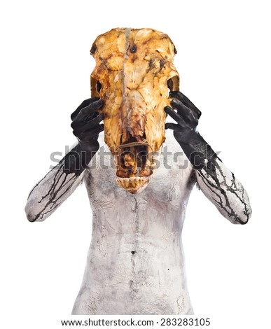 prehistoric man with veal skull - stock photo