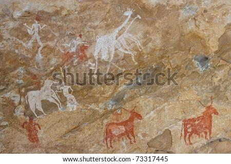Prehistoric Petroglyphs - Rock Art - Akakus (Acacus) Mountains, Sahara, Libya - stock photo