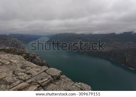 Preikestolen 2 Preikestolen or Prekestolen, also known by the English translations of Preacher's Pulpit or Pulpit Rock, is a famous tourist attraction in Forsand, Ryfylke, Norway. - stock photo