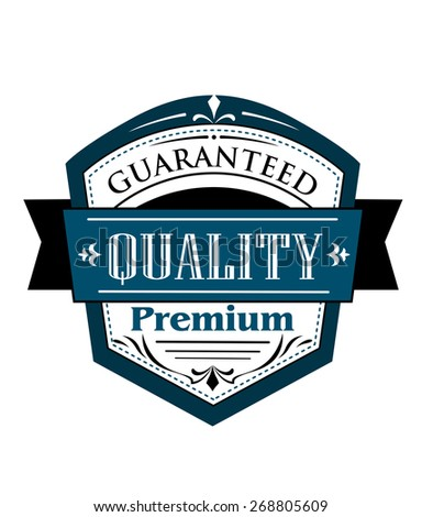 Premium Guaranteed Quality label design in blue and white with a shield containing text with a superimposed ribbon banner bearing the word  Quality - stock photo