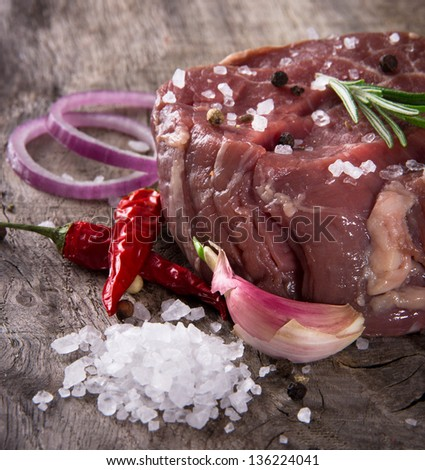 Premium Raw beef sirloin on wooden table - stock photo