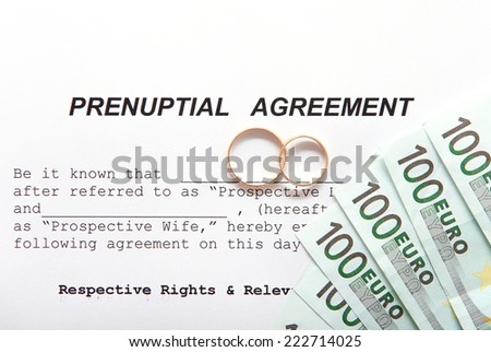 Prenuptial Agreement with wedding rings and euro notes - stock photo