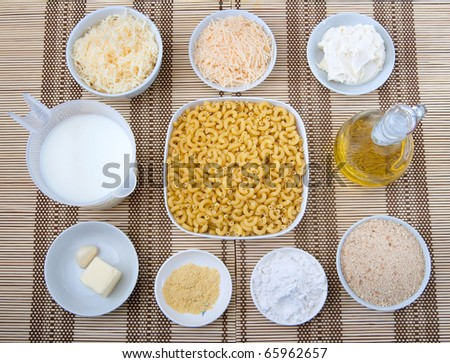 prep bowls full of ingredients for homemade macaroni and cheese - stock photo