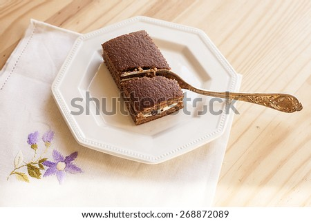 Prepackaged snack with milk and chocolate on white plate.