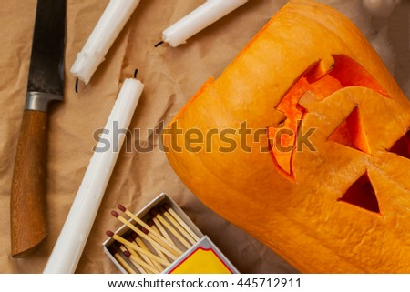 Preparation before the Halloween scary pumpkin - stock photo