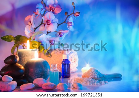 preparation for bath massage in chromotherapy in garden - cyan red  - stock photo