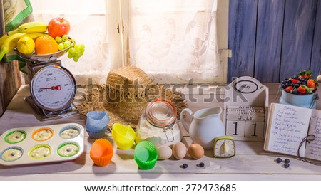 Preparation for delicious cupcakes with berry fruits - stock photo
