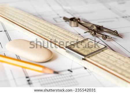 Preparation for drafting papers, the tools and schemes on the table. Angle view, focus on a pencil - stock photo