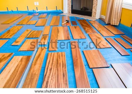 Preparation for installing planks of hardwood floor - stock photo