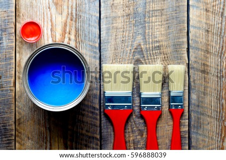preparation for painting wooden floor at home with blue paint