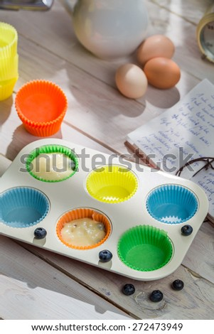 Preparation for tasty cupcakes with blueberries - stock photo