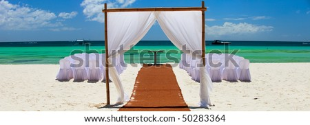 Preparation for wedding reception in tropical paradise - stock photo