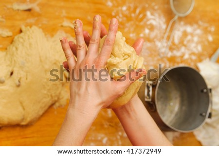 preparation meal food. modelling dough in a hands. Selective focus technique - stock photo