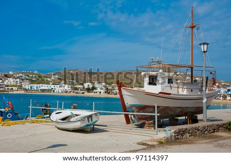 Preparation of a fishing boat for the season and fishing in the sea at the port of the Greek islands. - stock photo