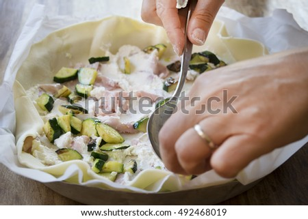 preparation of a quiche stuffing with variety of vegetables