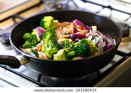 Preparation of baked vegetables in a pan. - stock photo