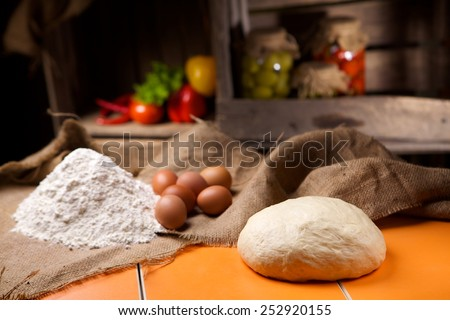 Preparation of bread in the kitchen. Kneading - stock photo
