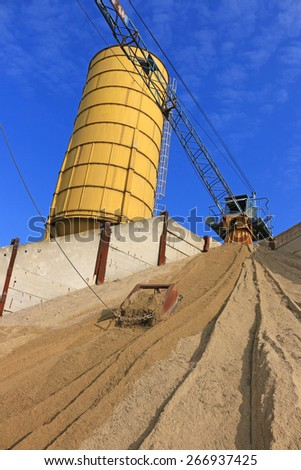 Preparation of construction materials, sand and gravel for building and concreting in gravel pit - stock photo