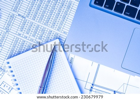Preparation of financial statements for the project, a notebook with a pen on the table. In blue tone - stock photo
