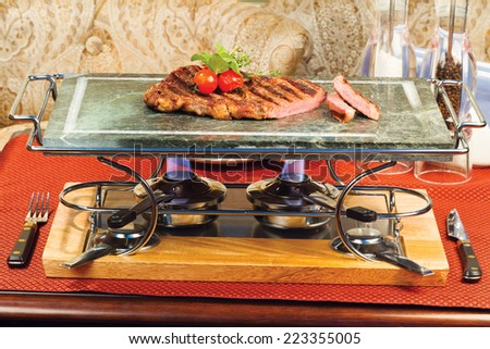 preparation of grilled meat with tomatoes on a marble tray - stock photo