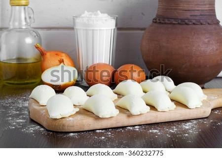 Preparation of homemade vareniki with stuffing - stock photo