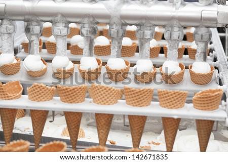 Preparation of ice-cream on factory - stock photo