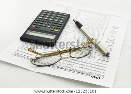 preparation of Internal Revenue Service form 1040 for income report and US tax return
